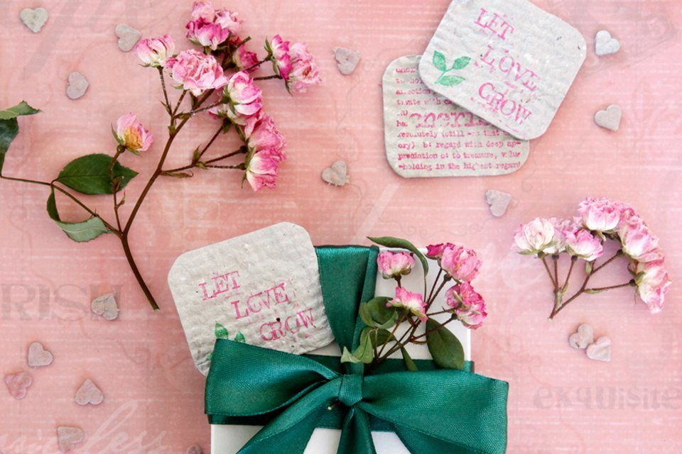 DIY seed paper Valentines with a ribbon wrapped gift box and dried roses