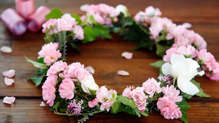 Homemade fresh flower crown with pink miniature roses