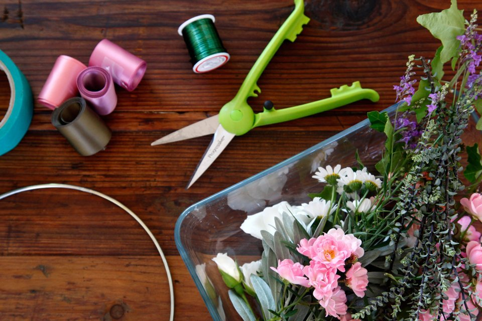 Craft supplies and cut flowers for making homemade flower crowns