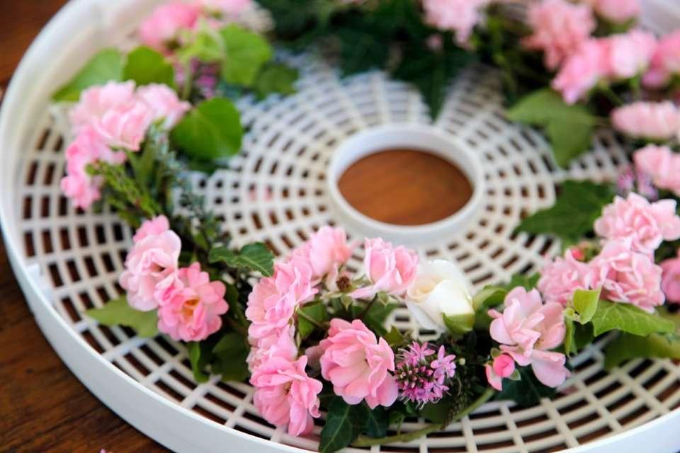 Fresh flower wreath on a dehydrator tray