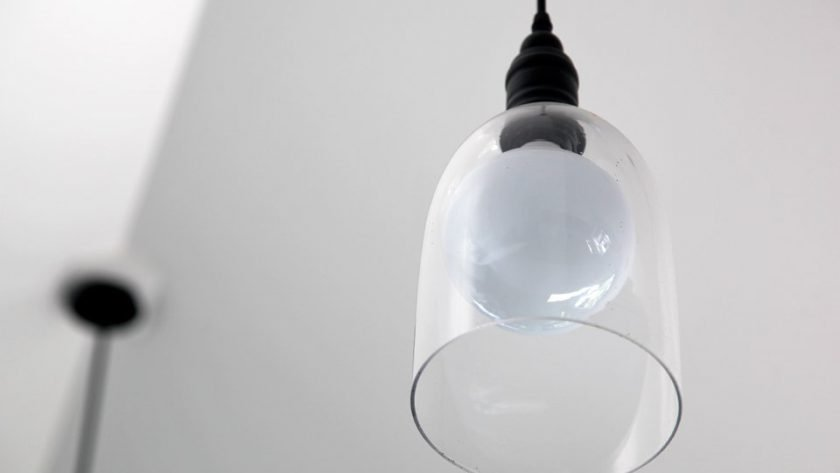 Glass pendant light with energy efficient bulb