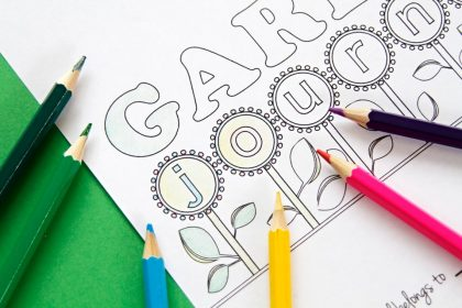 Coloured pencils and a children's garden journal colouring page