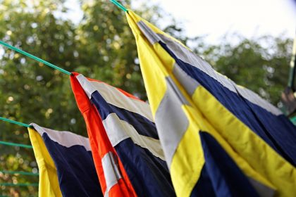 Reflective high-vis work shirts drying on a clothesline