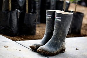 Muddy black gumboots