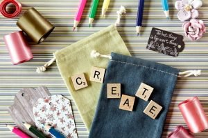 Colourful craft supplies with the word CREATE in scrabble tiles