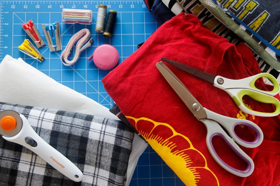 Materials for sewing a recycled t-shirt quilt